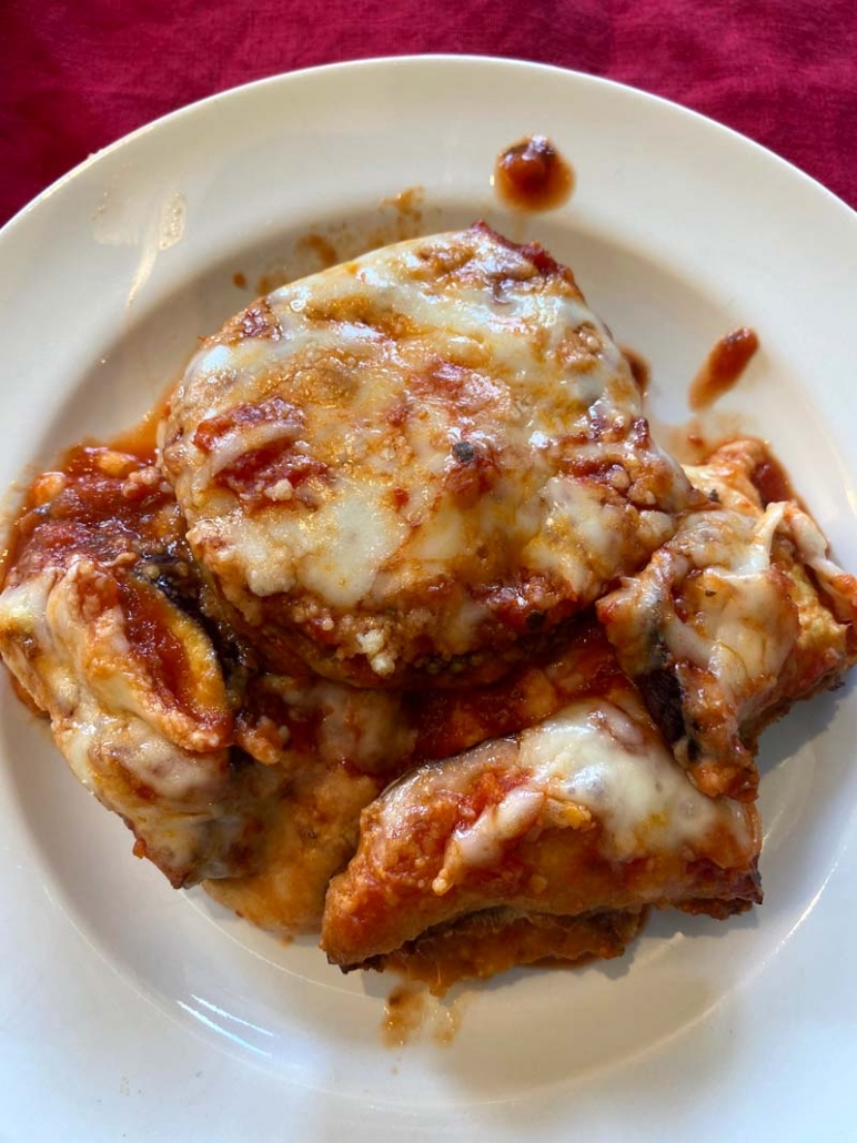 A plate of baked eggplant parmesan that is low-carb